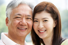 Portrait Of Chinese Father With Adult Daughter Stock Photos