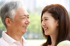 Portrait Of Chinese Father With Adult Daughter Stock Image