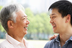 Portrait Of Chinese Father With Adult Son In Park Stock Photo