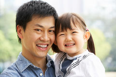 Portrait Of Chinese Father With Daughter In Park Stock Photography
