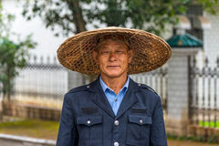 Portrait of Chinese man in traditional straw wide-brimmed hat Royalty Free Stock Photography