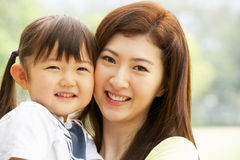 Portrait Of Chinese Mother With Daughter In Park Stock Photos