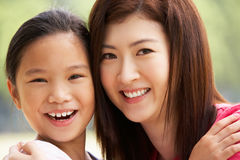 Portrait Of Chinese Mother With Daughter In Park Royalty Free Stock Image