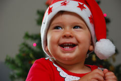 Portrait of Christmas baby boy in red Santa hat royalty free stock photos
