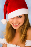 Portrait of Christmas woman. An attractive young woman in a red Christmas hat stock images