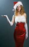 Portrait of a  christmas woman in beauty red dress Royalty Free Stock Photography