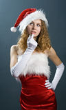Portrait of a  christmas woman in beauty red dress Royalty Free Stock Images
