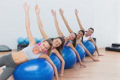 Portrait of class exercising on fitness balls Stock Photo