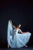 Portrait of the classical ballerina in white dress on black background. Portrait of the classical ballerina in white dress on the black background Stock Image