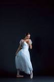 Portrait of the classical ballerina in white dress on black background. Portrait of the classical ballerina in white dress on the black background Stock Photos