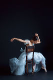 Portrait of the classical ballerina in white dress on black background. Portrait of the classical ballerina in white dress on the black background Royalty Free Stock Photography