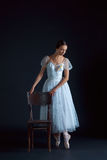 Portrait of the classical ballerina in white dress on black background Royalty Free Stock Photos
