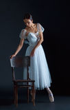 Portrait of the classical ballerina in white dress on black background. Portrait of the classical ballerina in white dress on the black background Royalty Free Stock Photos