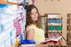 Portrait of clever student with book Royalty Free Stock Image