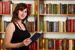 Portrait of clever student with open book Royalty Free Stock Photo