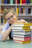 Portrait of clever student with open book reading Royalty Free Stock Photography