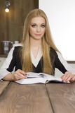Portrait of clever student reading book Royalty Free Stock Photography