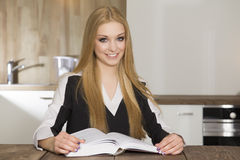 Portrait of clever student reading book Royalty Free Stock Photo