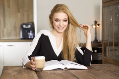 Portrait of clever student reading book Stock Image