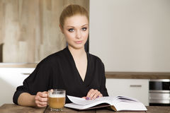 Portrait of clever student reading book Stock Images