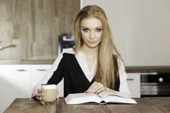 Portrait of clever student reading book Royalty Free Stock Image