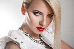 Portrait close up of adult serious beautiful blonde woman Royalty Free Stock Photo