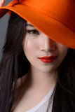 Portrait close up of beautiful asian woman model in orange strip Stock Photos