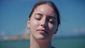 On a tropical beach close-up portrait of european beautiful cute brunette in with sunglass young woman or cheerful girl stock video