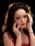 Portrait of a close-up dark-haired beautiful girl Royalty Free Stock Photography