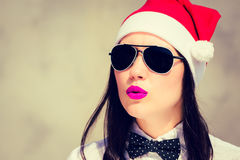 Portrait close up of a pretty young woman in Santa Claus hat. And sunglasses with bright painted pink lips stock photos