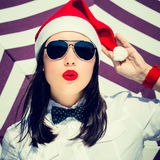 Portrait close up of a pretty young woman in Santa Claus hat Stock Image
