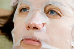 Portrait  close-up woman applying rejuvenating facial mask on h Stock Photo