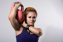 Portrait close up of young attractive female doing kettle bell e Royalty Free Stock Photos
