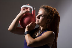 Portrait close up of young attractive female doing kettle bell e Stock Image