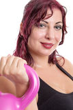 Portrait close up of young attractive female doing kettle bell e Stock Photography