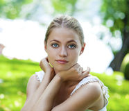 Portrait close up of young beautiful blonde woman, on background Royalty Free Stock Photos