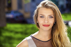 Portrait close up of young beautiful blonde woman, on background Royalty Free Stock Image