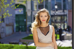 Portrait close up of young beautiful blonde woman, on background Royalty Free Stock Images