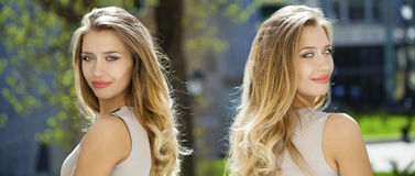 Portrait close up of young beautiful blonde woman, on background Stock Images