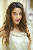 Portrait close up of young beautiful brunette woman in beige dre Stock Photo