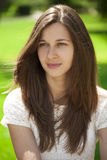 Portrait close up of young beautiful brunette woman. Summer outdoors Stock Photography