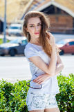 Portrait close up of young beautiful brunette woman. Summer outdoors Royalty Free Stock Photo
