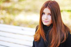 Portrait close-up of young beautiful girl on a background autumn street stock images