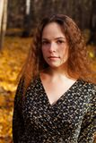 Portrait close up of young beautiful woman, on background autumn Stock Photo