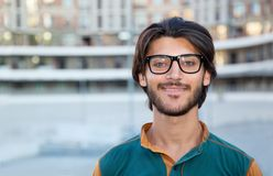 Portrait close up of a young muslim man with glasses. Close up portrait of a young muslim man with glasses. Student royalty free stock images
