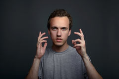 Portrait closeup funny confused skeptical man thinking looking in camera isolated on gray wall background with copy Royalty Free Stock Images