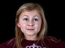 Portrait closeup young girl on black background Royalty Free Stock Images