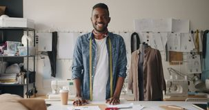 Portrait of clothes designer looking at camera standing in studio with dummy stock video footage