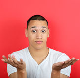 Portrait of clueless man against red background Royalty Free Stock Photography