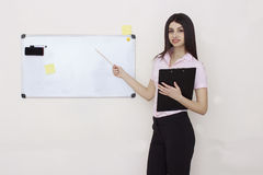 Portrait of coaching woman. Holding pointer and tablet Stock Photography
